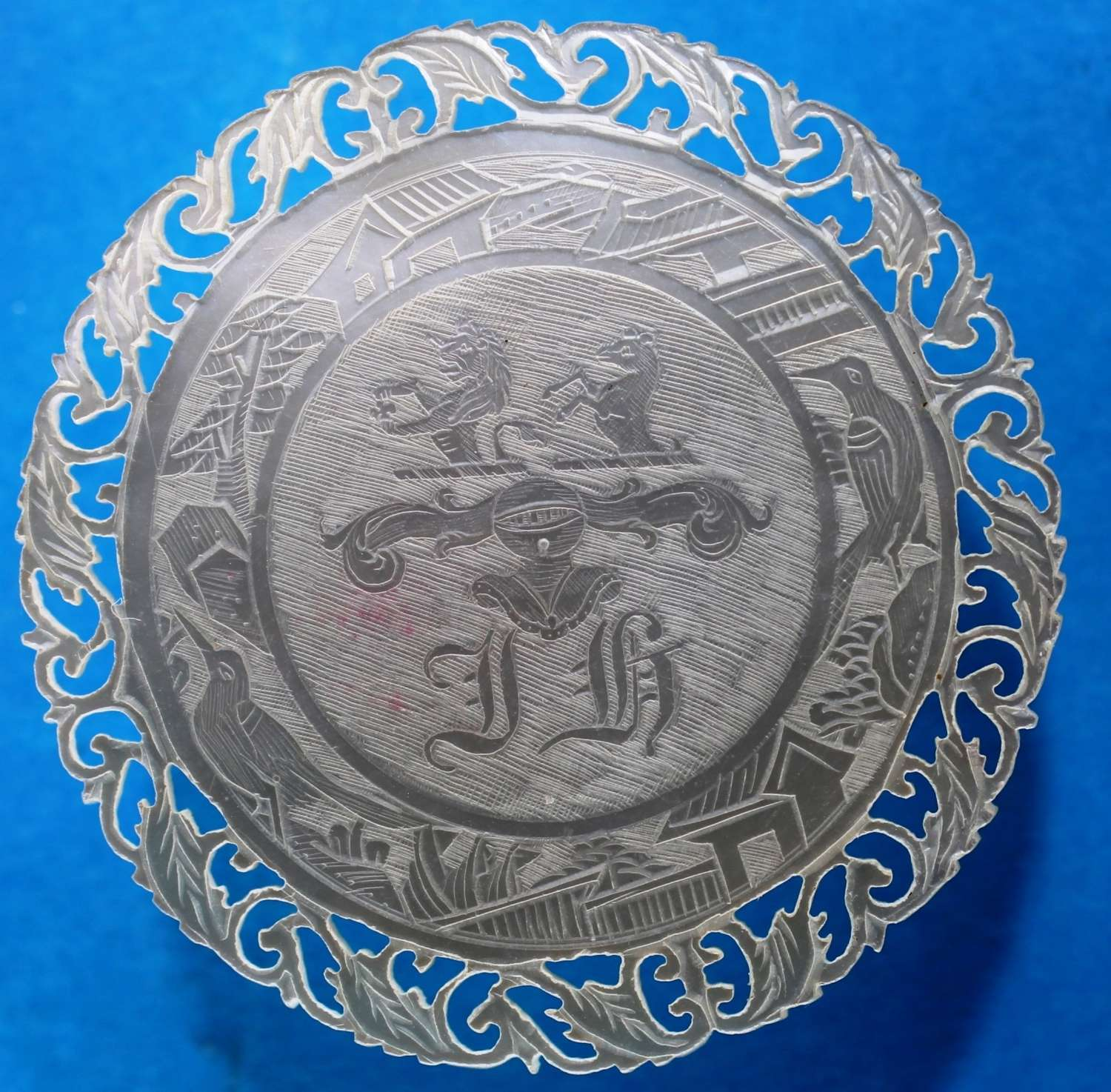 Superb fretted counter with two crests